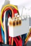 Prise endommagée de ligne électrique Photographie stock libre de droits