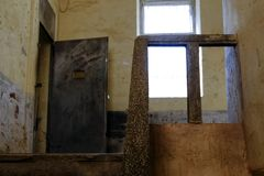 Prison stone stairs and metal door stock photo