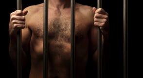 Prisioneiro atrás das barras imagens de stock royalty free