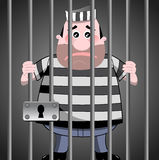 Prisioneiro atrás das barras Fotos de Stock