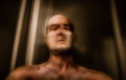 Prisioneiro obscuro do homem no elevador Imagem de Stock
