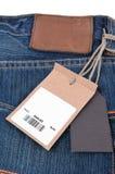 Prislapp med barcoden på jeans Royaltyfria Foton