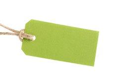 Prislappen från återanvänt papper tvinnar på kabel som isoleras på vit Royaltyfri Bild