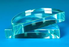 Prism. Semi circular shaped prism with a blue background Stock Images