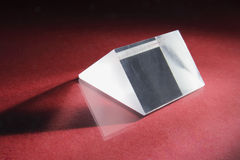 Prism. Glass Prism on Red Background royalty free stock photo