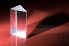 Prism. Glass Prism on Red Background royalty free stock photos