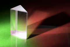 Prism. Glass Prism on Green and Red Background stock images