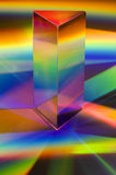 Prism With Rainbows. Prism with abstract rainbow effects.  Vertical format Royalty Free Stock Image