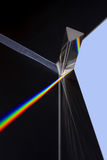 Prism splitting white light into a spectrum on a black background.  stock images