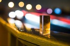 Prisma på natten med färgrika ljus i bakgrunden Fotografering för Bildbyråer