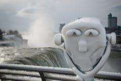 Prismáticos congelados de visita turístico de excursión de Niagara Falls Foto de archivo libre de regalías