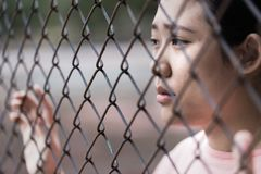 Prison asian teen behide cage. With sad in jail royalty free stock images
