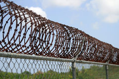 Prison. Barbed fence, security wall Stock Photo