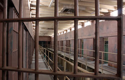 Prison bars. View through the upper tier of a cellblock in a state prison from behind the guard's protective post