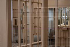 Prison bars, close up. Prison bars with checkpoint, cell, jail, corridor, penitentiary, justice, criminal, old, building, crime, interior, security, metal stock photo