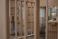 Prison bars, close up. Prison bars with checkpoint, cell, jail, corridor, penitentiary, justice, criminal, old, building, crime, interior, security, metal stock photos