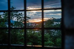 Prison bars and dramatic colorful sunset royalty free stock photography