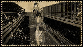 Prison bars and a hallway postage stamp 3d rendering Royalty Free Stock Photography