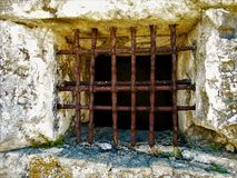 Prison bars. Iron prison bars in old fortress on island Corfu in Greece Stock Images