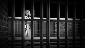 Prison bars and Lady of Justice 3d rendering. Prison bars and Lady of Justice Royalty Free Stock Photography