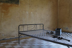 Prison bed 3. A prison bed in S21 Detention Centre, Cambodia Stock Image