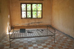 Prison bed. A prison bed in s21 the notorious prison where more than 11,000 prisoners and their families were tortured and killed. Only 6 survived. This is an stock photography