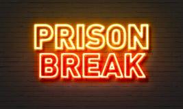 Prison break neon sign on brick wall background. Stock Photo