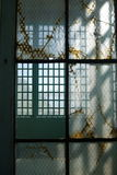 Prison: broken glass steel windows v Stock Photos