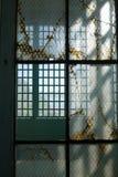 Prison: broken glass steel windows v Stock Photos
