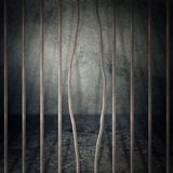 Prison cell. Obsolete gray grunge concrete room, prison cell with metal bars Stock Photography