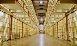 Prison cell block with cells on both sides. royalty free stock images