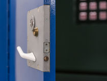 Prison cell door. Open dark in cell royalty free stock photo