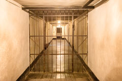 Prison cell with iron bars Stock Photo