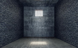 Prison cell with light shining through a barred window Royalty Free Stock Images