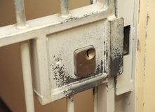 Prison cell lock. A heavy lock on a bar type prison gateway Stock Photos