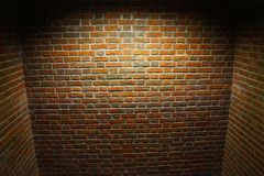 Prison cell, walls of raw bricks, dark and cold stock image