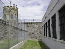 Prison. Cells, barbed fence and guard tower behind it Stock Photo