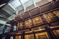 Prison cells in big jail and security guard. Prison cells in big jail and security guard Royalty Free Stock Photo