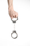 Prison and convicted topic: man hands with handcuffs isolated on white background in studio, put handcuffs on killer Royalty Free Stock Images