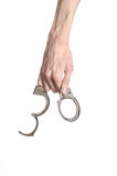 Prison and convicted topic: man hands with handcuffs isolated on white background in studio, put handcuffs on killer Stock Photography