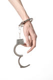 Prison and convicted topic: man hands with handcuffs isolated on Royalty Free Stock Photography