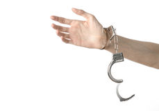 Prison and convicted topic: man hands with handcuffs isolated on Royalty Free Stock Photo