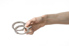 Prison and convicted topic: man hands with handcuffs isolated on. White background in studio, put handcuffs on killer studio Royalty Free Stock Photography