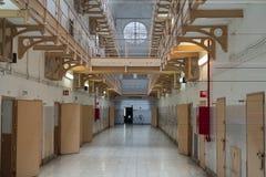 Prison corridor with prison cells. Doors, jail, bar, penitentiary, justice, criminal, old, building, crime, interior, security, metal, prisoner, punishment stock image