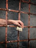 Prison corruption. Conceptual image about bribery and corruption in prisons Royalty Free Stock Image