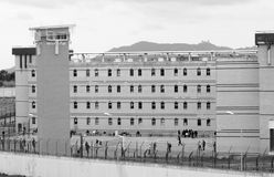 Prison Courtyard, Inmates, Legal System - B&W Photo. Black and white photo: building and sentry tower from a State Prison; Inmates on courtyard Royalty Free Stock Images