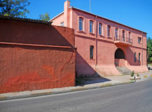 Prison exterior. Painted pink walls of a prison façade on a sunny day Royalty Free Stock Photography