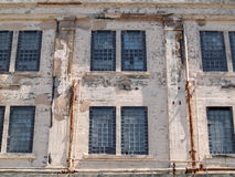 Prison facilities rusted windows on exterior wall Stock Photo