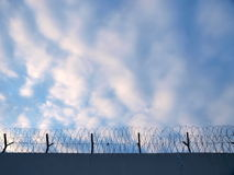 Prison fence. With razor wire stock photos