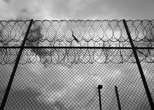 Prison fence. Stark prison fence with razor wire. Horizontal monochrome Stock Images